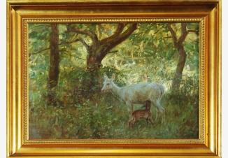 Самка оленя с оленёнком в весеннем лесу